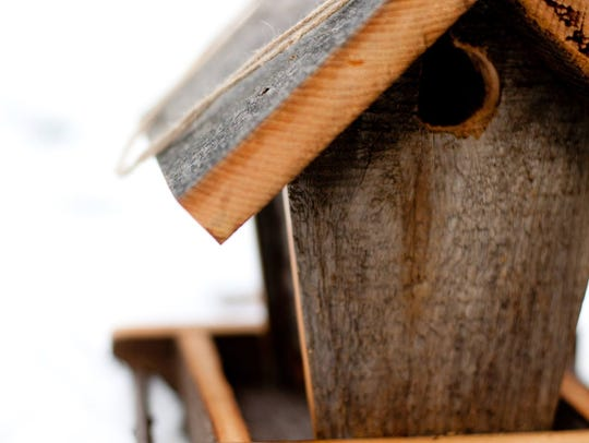 Nicholas Hardrath of Shorewood makes birdhouses using