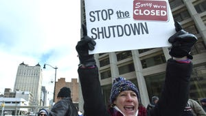 Environmental Protection Agency (EPA) budget analyst Tricia Paff, of Dexter, during a protest in front of the McNamara Federal Building in Detroit on Thursday