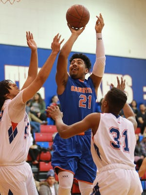 Canutillo's Nathan Eggleton, center, shoots between Irvin defenders Frank Loya, left, and Daaron Saleem during the second quarter Tuesday.