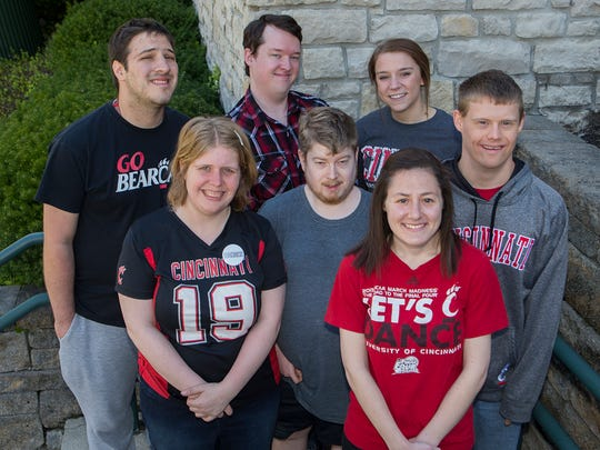 Stephen Krawee, Karly Saeks, Benjamin Minney, Brett Eisentrout, student teacher Erin Vogt, Arielle Bachrach and Peter Merz (left to right) were members of the first graduating class of the Transition and Access Program at the University of Cincinnati.