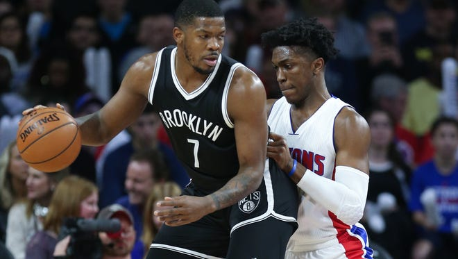Pistons forward Stanley Johnson defends against Nets forward Joe Johnson during the first period of the Pistons' 103-89 win Saturday at the Palace.