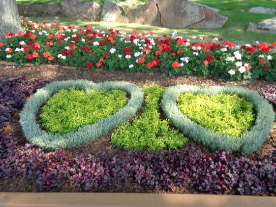 Flowers planted in the shape of a heart adorn Heart