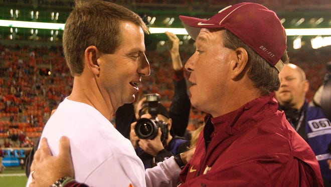 Clemson Tigers head coach Dabo Swinney (left) shakes hands with Florida State Seminoles head coach Jimbo Fisher (right) prior to the game at Clemson Memorial Stadium.