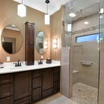 The shower is easily accessible, but with an enclosure that allows the steam to stay in.