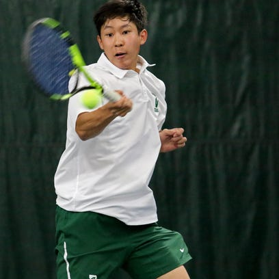 Justin Wang of Delbarton returns a forehand during the Morris County Tournament first singles final.
