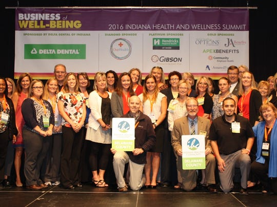 Delaware County receives its Healthy Community award from the Indiana Wellness Council.