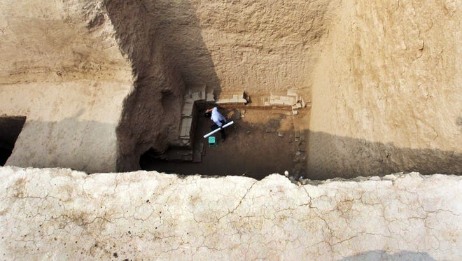 Chinese archaeologists work inside the newly discovered tomb of Shangguan Wan'er, a 7th-century female politician who was one of the most powerful women in ancient Chinese history, near an airport in Xianyang, northwest China's Shaanxi province on Sept. 11, 2013.