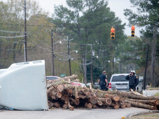 A log truck overturned at the intersection of Rosa