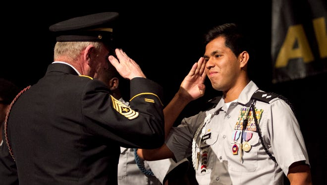 Miguel Gutierrez is awarded a gold medal for an American Legion Award for Demonstrating Military & Scholastic Excellence during the <137>School District of Lee County JROTC<137> awards ceremony Thursday<137> evening at Harborside Event Center in Fort Myers<137>. To see more photos visit <137>www.<137>news-press.com.