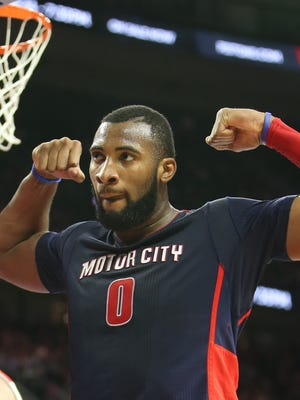 Pistons center Andre Drummond reacts after scoring against Wizards center Marcin Gortat during the fourth period of the Pistons' win Sunday at the Palace.