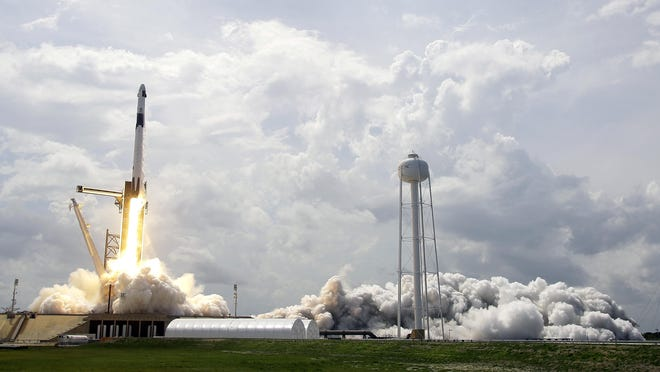 SpaceX Falcon 9, with NASA astronauts Doug Hurley and Bob Behnken in the Dragon crew capsule, lifts off Saturday from Pad 39-A at the Kennedy Space Center in Cape Canaveral, Fla. For the first time in nearly a decade, astronauts blasted towards orbit aboard an American rocket from American soil, a first for a private company.