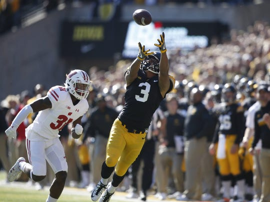 Iowa receiver Jay Scheel reaches out for the ball, but was unsuccessful in making the catch against Wisconsin on Saturday, Oct. 22, 2016, at Kinnick Stadium in Iowa City.