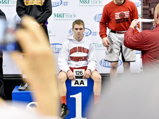 Bermudian Springs' Austin Clabaugh sits on the podium