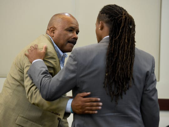 Maurice Banks embraces his son Brandon at the 23-year-old's trial in the Vanderbilt rape case at the Justice A. A. Birch Building on June 20, 2017.