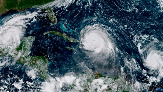 In this geocolor image GOES-16 satellite image taken Sept. 7, 2017, at 11:15 a.m., shows the eye of Hurricane Irma, center, just north of the island of Hispaniola, with Hurricane Katia, left, in the Gulf of Mexico, and Hurricane Jose, right, in the Atlantic Ocean. Irma, a fearsome Category 5 storm, cut a path of devastation across the northern Caribbean, leaving at least 10 dead and thousands homeless after destroying buildings and uprooting trees on a track Thursday that could lead to a catastrophic strike on Florida.
