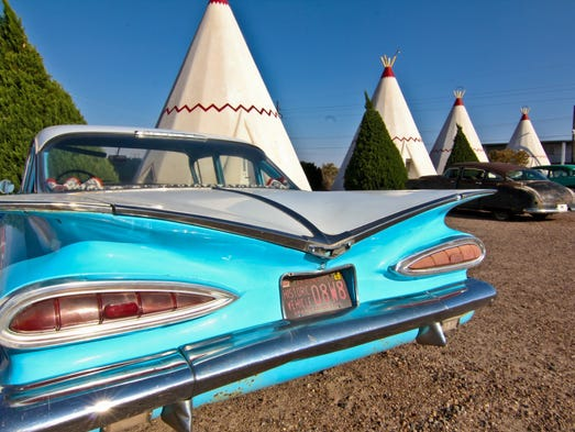 Vintage cars parked in front of each unit complete the time capsule experience at the Wigwam Motel in Holbrook.