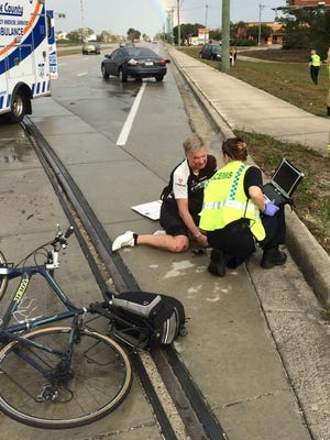 A crash occurred on Alico Road Sunday when a driver stopped to aid a fallen bicyclist.
