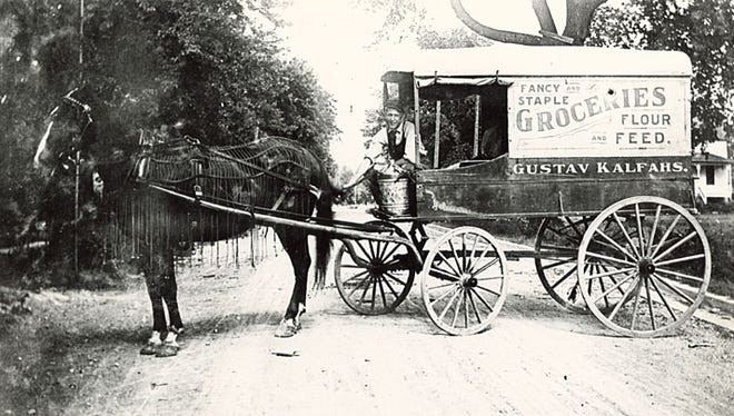 This undated photograph shows the Gustav Kalfahs Grocery delivery wagon. The Kalfahs Grocery was located at 110 W. Wisconsin Ave., Neenah. Gustav was the mayor of Neenah in 1900.