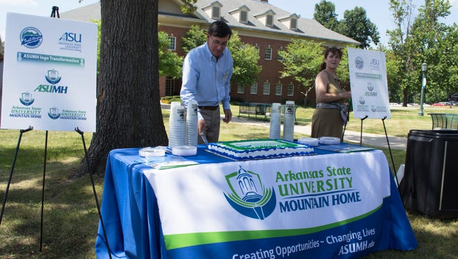 ASUMH Chancellor Dr. Robin Myers (left) and Jodie Elizabeth Jeffrey (right) of Brooks-Jeffrey Marketing, Inc., are pictured at a celebration of the formal adoption of the new ASUMH logo on Monday.