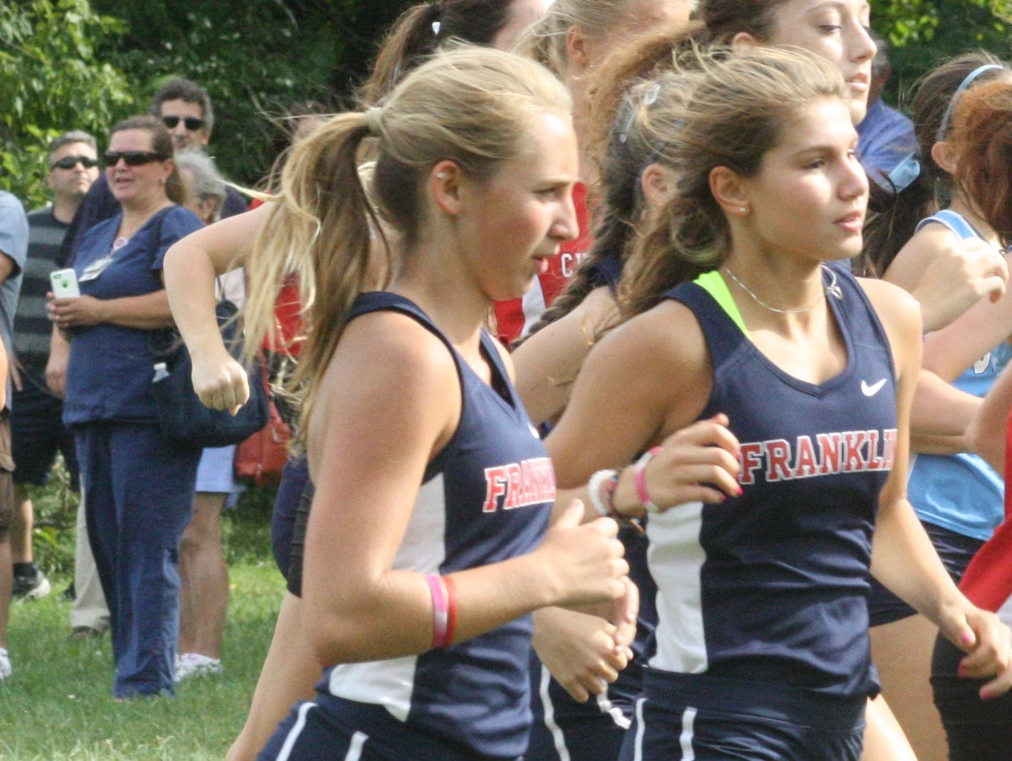 Franklin harriers Sam Mackiewicz (left) and Kaylee English (right) are pictured during a meet earlier this season.