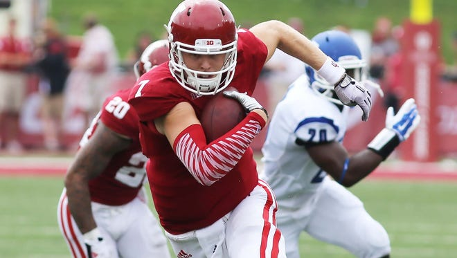 IU's QB Nate Sudfeld spent some time scrambling after finding receivers covered on many pass attempts. Indiana University defeated Indiana State University 28-10 in a football game at Memorial Stadium in Bloomington Saturday August 30, 2014.