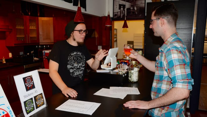 Kyle Cushman serves a sample to Erik Halperin at Bos Meadery in Madison.