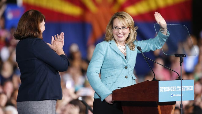 Congresswomen Ann Kirkpatrick and Gabby Giffords take the stage before Democratic presidential candidate Hillary Clinton speaks at a rally at ASU in Tempe on Nov. 2, 2016.