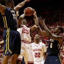 Indiana forward Emmitt Holt tries to put up a shot in traffic during a NCAA men's basketball game on Friday, Nov. 28, 2014, at Assembly Hall in Bloomington. (James Brosher / For The Star)