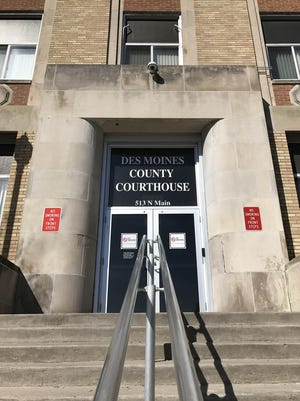 The Des Moines County courthouse will open Monday, but visitors must use the handicap entrance on the south side of the building. The front entrance doors will remain locked.