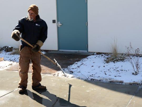 Senior groundskeeper Lou Rhinehart pauses from using
