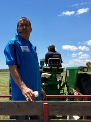 Kewaunee County farmer Randy Ebert talks about alfalfa harvesting on his farm near Algoma as part of a media day for the Kewaunee County Wisconsin Farm Technology Days scheduled for July 11-13.