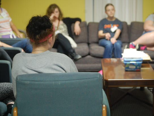 Teens meet together at Lost & Found to talk about the