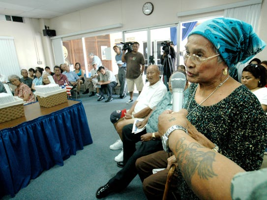In this file photo, residents testify about war reparations