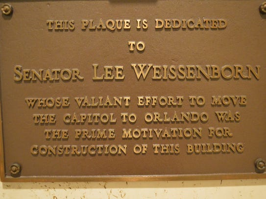 This plaque on the first floor of the new capitol pays