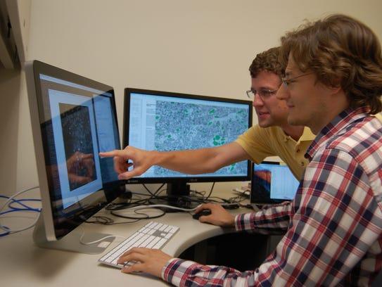 Derek Rose, front, and Matthew Eicholtz look at 3D