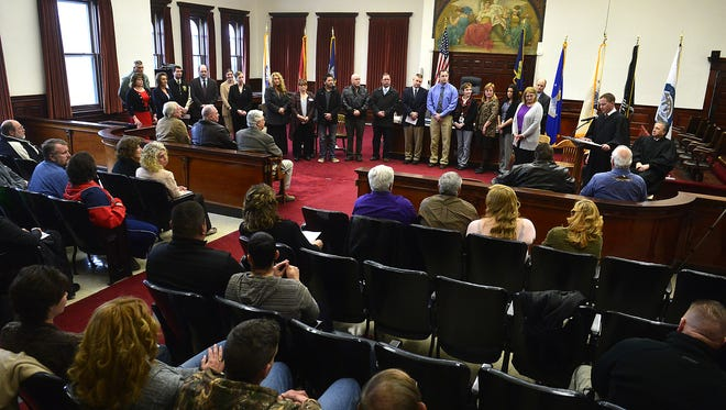 The 8th Judicial District Veterans Court team is recognized during the inaugural graduation ceremony in March in the Cascade County Courthouse.