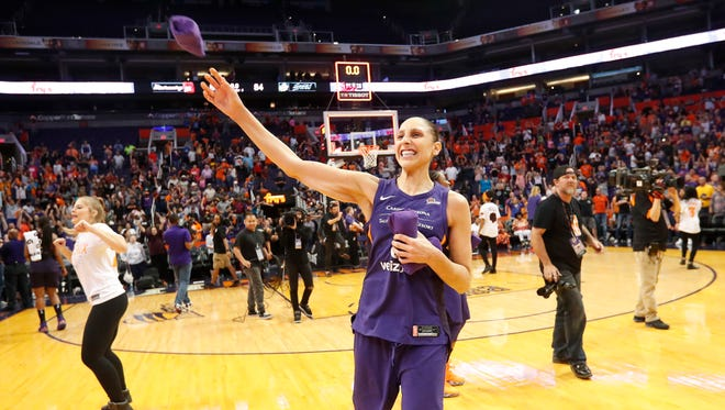 Phoenix Mercury forward Diana Taurasi (3) throws a t-shirt towards fans after beating the Seattle Storm 86-84 in Game 4 of WNBA semifinals at Talking Stick Resort Arena September 2. 2018.