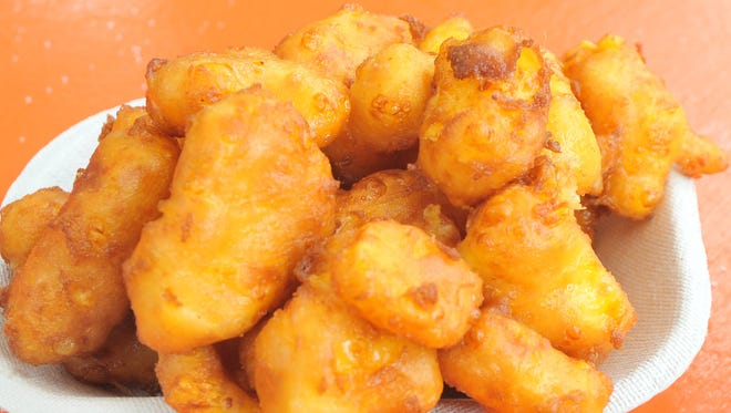 Those attending the Green Bay Bullfrogs Cheese Curdfest get to vote for the best deep fried curds and other favorites.
