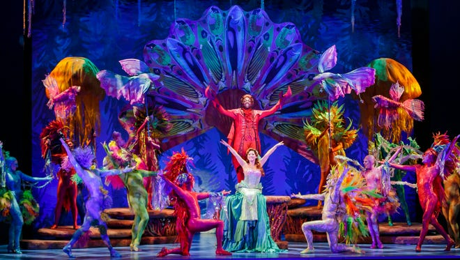 """A scene from the """"Under the Sea"""" musical number in """"Disney's The Little Mermaid,"""" playing at the Aronoff Center through Jan. 29 as part of the Broadway in Cincinnati series. Featured in the number are Melvin Abston as Sebastian the crab (center, in red) and below him, Diana Huey in the title role."""