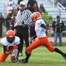 Grant Hood kicks the two-pointer with Christian Williams holding in the Northville Stallions' 24-8 varsity win Saturday over the Livonia Orioles.