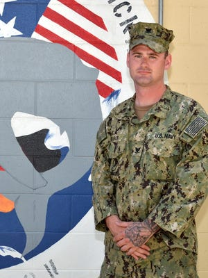 Petty Officer Third Class Mark Rigie, a construction mechanic, is serving where U.S. Pacific Fleet Headquarters is located.