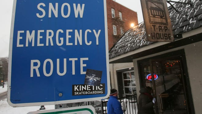 For some, a snow emergency route leads right to the Trolley Square establishments such as the Trolley Tap House in Wilmington during Delaware's first significant snowfall of the season Saturday.