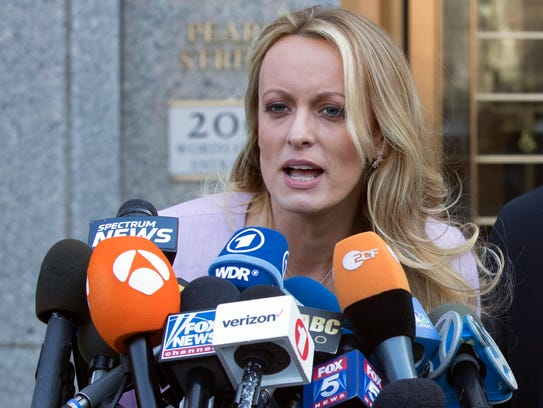 Adult film actress Stormy Daniels speaks outside federal