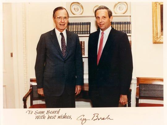 Sam Beard is shown with President George Bush. Beard, of Delaware, has created programs for seven U.S. presidents
