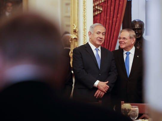 Israeli Prime Minister Benjamin Netanyahu, center,