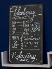 """A chart on the wall of the Breakwater Treatment & Wellness dispensary with information about the """"Blueberry"""" strain of marijuana."""