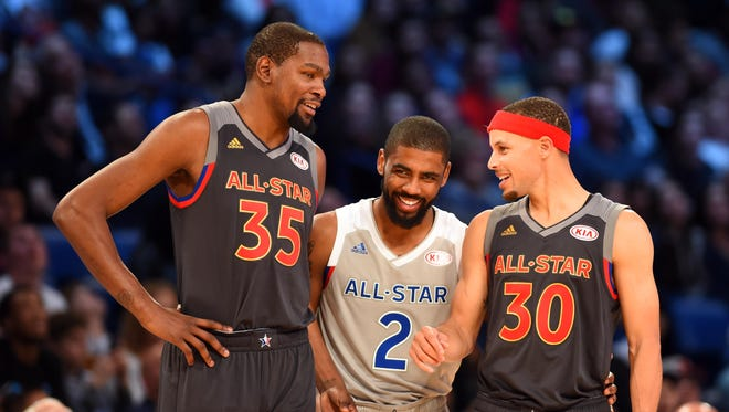 Feb 19, 2017; New Orleans, LA, USA; Western Conference forward Kevin Durant of the Golden State Warriors (35),  Eastern Conference forward Kyrie Irving of the Cleveland Cavaliers (2) and Western Conference guard Stephen Curry of the Golden State Warriors (30) talk in the 2017 NBA All-Star Game at Smoothie King Center.
