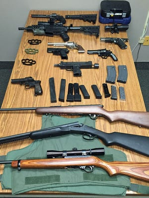 Northvale police executing a search warrant seized dozens of knives, swords, guns, brass knuckles and high-capacity magazines from a borough man's home.