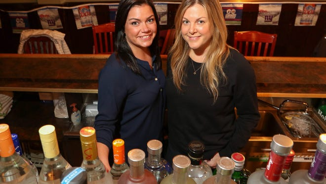 Bartenders Lindsay Hill and Robin Matthews work at Collins Bar & Restaurant, a cozy and welcoming destination in Morris Plains.