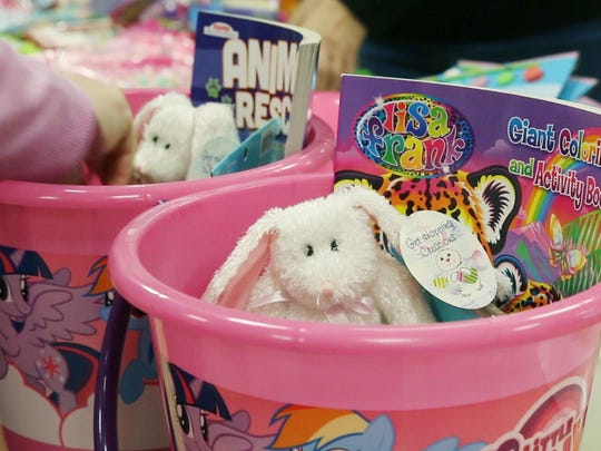 Volunteers from Helping Families in Need create Easter baskets for hundreds of children in Ocean County. The organization is providing these gifts to children who may otherwise not receive one. 